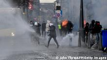 People take part in clashes in the centre of Liege, eastern Belgium, on March 13, 2021 that erupted on the sidelines of a Black Lives Matter demonstration. - Several police officers were wounded when violence and looting broke out on the sidelines of a Black Lives Matter demonstration in the eastern Belgian city of Liege on March 13, 2021, police said. The march was held to protest against the arrest of a woman for rebellion in the city at the begining of the week, who has since accused the police of racism, a police spokeswoman said. (Photo by JOHN THYS / AFP) (Photo by JOHN THYS/AFP via Getty Images)