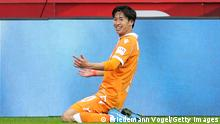 LEVERKUSEN, GERMANY - MARCH 14: Masaya Okugawa of DSC Arminia Bielefeld celebrates after scoring their side's second goal during the Bundesliga match between Bayer 04 Leverkusen and DSC Arminia Bielefeld at BayArena on March 14, 2021 in Leverkusen, Germany. Sporting stadiums around Germany remain under strict restrictions due to the Coronavirus Pandemic as Government social distancing laws prohibit fans inside venues resulting in games being played behind closed doors. (Photo by Friedemann Vogel - Pool/Getty Images)