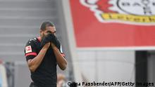 Leverkusen's German defender Jonathan Tah looks up after the end of the German first division Bundesliga football match Bayer 04 Leverkusen v Arminia Bielefeld in Leverkusen, western Germany, on March 14, 2021. - DFL REGULATIONS PROHIBIT ANY USE OF PHOTOGRAPHS AS IMAGE SEQUENCES AND/OR QUASI-VIDEO (Photo by Ina Fassbender / various sources / AFP) / DFL REGULATIONS PROHIBIT ANY USE OF PHOTOGRAPHS AS IMAGE SEQUENCES AND/OR QUASI-VIDEO (Photo by INA FASSBENDER/POOL/AFP via Getty Images)