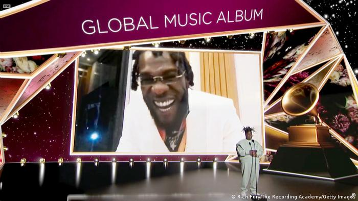 Burna Boy laughs as he accepts the Grammy for best global music album