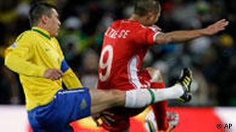Brazil's Lucio, left, competes for the ball with North Korea's Jong Tae Se