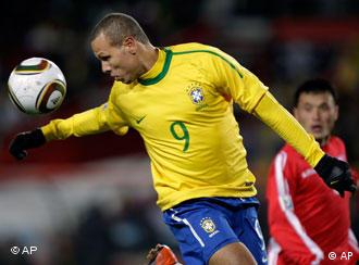 Luis Fabiano controls the ball