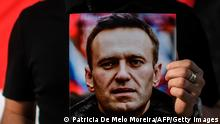 Portrait of Alexei Navalny held by demonstrator in Lisbon