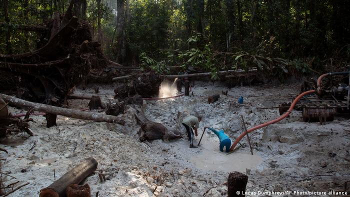 Men search for gold at an illegal gold mine in the Amazon jungle in the Itaituba area of Para state, Brazil