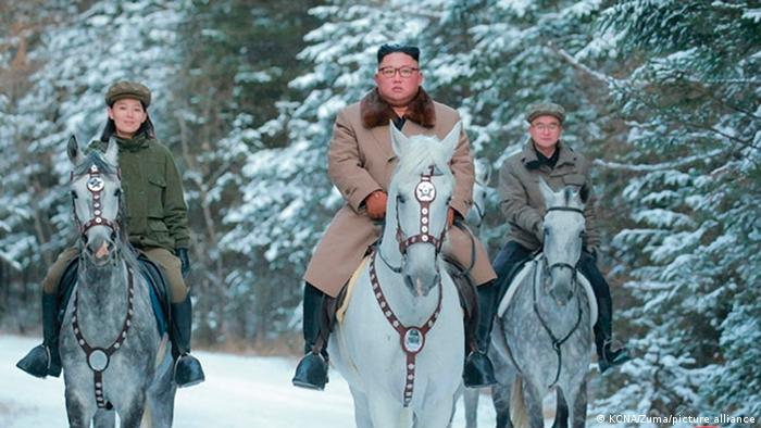 Kim Yo Jong (left) rides alongside her brother during a visit to the holy mountain of Paektu