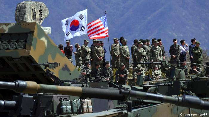 US and South Korean troops stand among military equipment