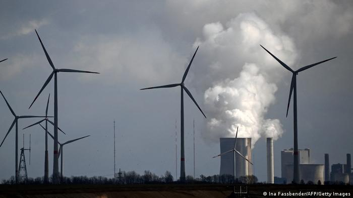 Winturbines in front of a coal plant in Neurath, Germany