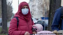 Sahar Kalsoon and her daughter on a winter street in Leipzig