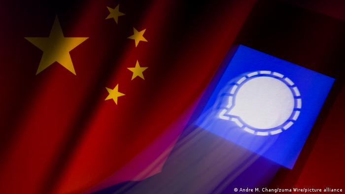 the signal messaging app icon projected on the Chinese flag