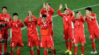 North Korea players applaud fans at the end of the World Cup group G soccer match between Brazil and North Korea