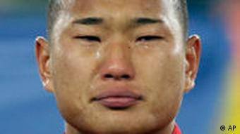 Jong Tae Se was overcome with emotion as he listens to the national anthem before the match with Brazil
