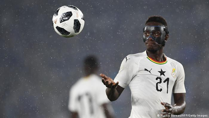 Andy Yiadom catches the ball in a game for Ghana.