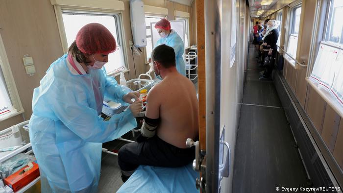 A man receives a dose of Sputnik V vaccine in Russia.