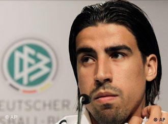 Sami Khedira and Real Madrid club badge
