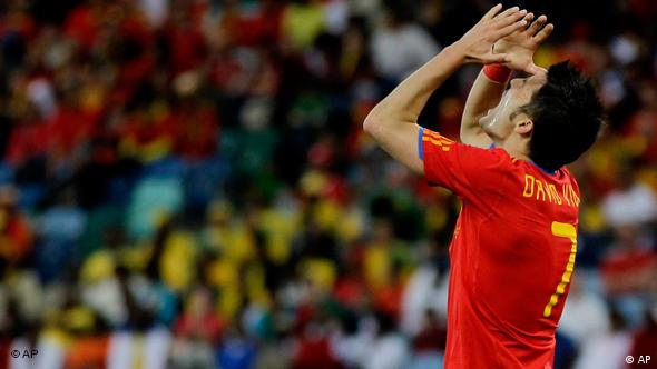Spain's David Villa reacts during the World Cup group H soccer match between Spain and Switzerland at the stadium in Durban, South Africa, Wednesday, June 16, 2010.