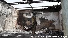 A soldier stands at a damaged house in Bosso military camp on June 17, 2016 following attacks by Boko Haram fighters in the region. Boko Haram on June 9 attacked a military post in Bosso in Niger's Diffa region, killing 26 soldiers. / AFP / ISSOUF SANOGO (Photo credit should read ISSOUF SANOGO/AFP via Getty Images)