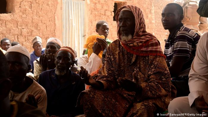 File photo of villagers in western Niger meeting after an attack by armed men.