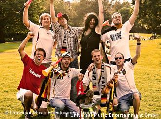 Christian Landgraf dressed as Lena with other members of Uwu Lena wearing German jerseys