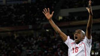 Switzerland's Gelson Fernandes, right, celebrates with teammate Switzerland's Tranquillo Barnetta, left, after scoring the opening goal during the World Cup group H soccer match between Spain and Switzerland at the stadium in Durban, South Africa, Wednesday, June 16, 2010.