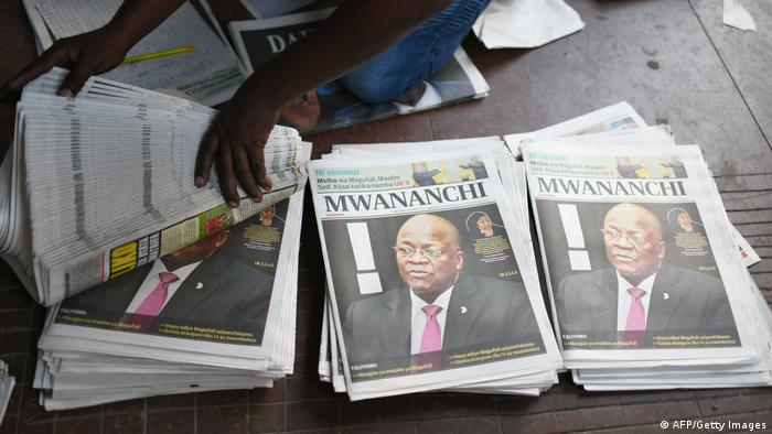 Newspapers with a picture of Tanzania's late president Magufuli.