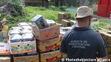 (150729) -- JALISCO, July 29, 2015 () -- An agent of the Criminal Investigation Agency guards seized marijuana, in Tlajomulco de Zuniga, Jalisco state, Mexico, on July 28, 2015. The Republic's Attorney General of Mexico reported on Tuesday the confiscation of over five tons of marijuana in Tlajomulco de Zuniga municipality, Jalisco state. (Xinhua/NOTIMEX)