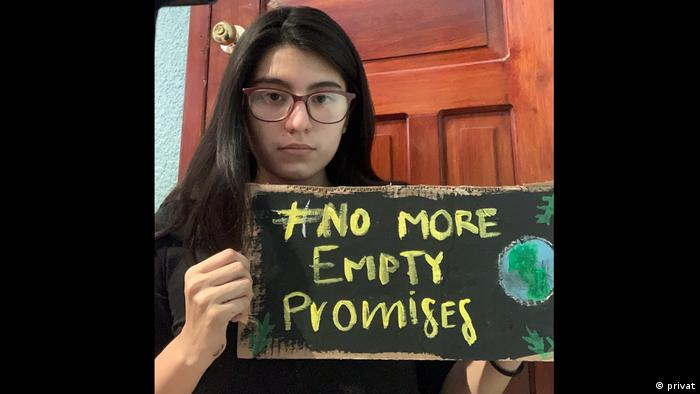 Adriana Calderon, Fridays for Future Mexico, with a sign that reads #No More Empty Promises