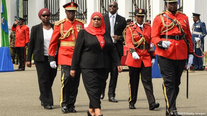 New Tanzanian President Samia Suluhu Hassan (C) inspects a military honor guard after a swearing-in ceremony