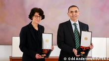 German scientists, CEOs and founders of BioNTech, Ozlem Tureci and Ugur Sahin pose with the Bundesverdienstkreuz (Federal Cross of Merit) awarded to them by German President Frank-Walter Steinmeier, at the presidential Bellevue Palace in Berlin, Germany March 19, 2021 Odd Andersen/Pool via REUTERS