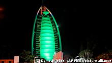 Burj Al Arab, a seven star luxury hotel is lit up in green for St. Patrick's Day in Dubai, United Arab Emirates, Wednesday, March 17, 2021. (AP Photo/Kamran Jebreili)
