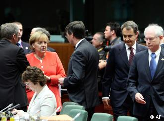 German Chancellor Angela Merkel, second left, speaks with Belgium's Prime Minister Yves Leterme, left, and Dutch Prime Minister Jan Peter Balkenende