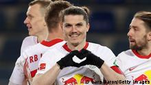 BIELEFELD, GERMANY - MARCH 19: Marcel Sabitzer of Leipzig celebrates scoring the opening goal during the Bundesliga match between DSC Arminia Bielefeld and RB Leipzig at Schueco Arena on March 19, 2021 in Bielefeld, Germany. (Photo by Lars Baron/Getty Images)