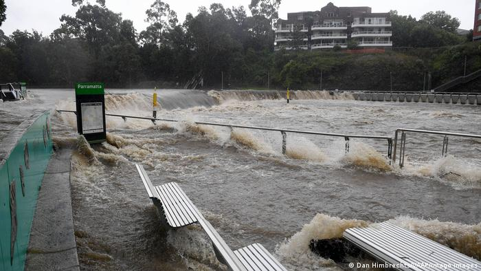 The swollen Parramatta river is seen breaking its banks at the Charles St weir and ferry wharf, at Parramatta in Sydney