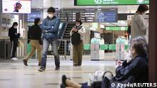 People sit on the floor at a station as train services are suspended following an earthquake in Sendai, Miyagi prefecture, Japan in this photo taken by Kyodo on March 20, 2021. Mandatory credit Kyodo/via REUTERS ATTENTION EDITORS - THIS IMAGE WAS PROVIDED BY A THIRD PARTY. MANDATORY CREDIT. JAPAN OUT. NO COMMERCIAL OR EDITORIAL SALES IN JAPAN.
