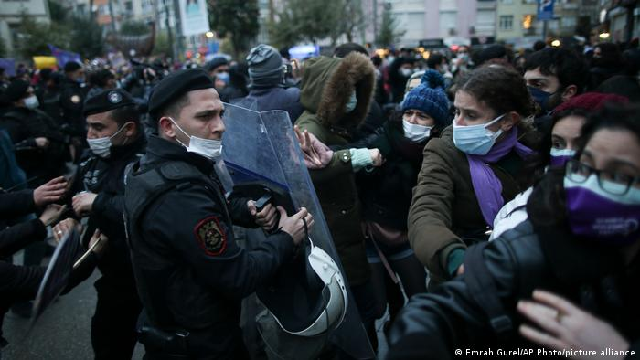 Police with riot shields face off mostly female protesters in Istanbul