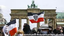 BERLIN, GERMANY - MARCH 20: People gather around Brandenburg Gate to stage a protest against coronavirus (Covid-19) measures in Berlin, Germany on March 20, 2021. Police officers ended the demonstration on the grounds that the mask and distance rules were not followed. The demonstrators were later removed from the area accompanied by the police. Many people were detained in the protest. Abdulhamid Hosbas / Anadolu Agency