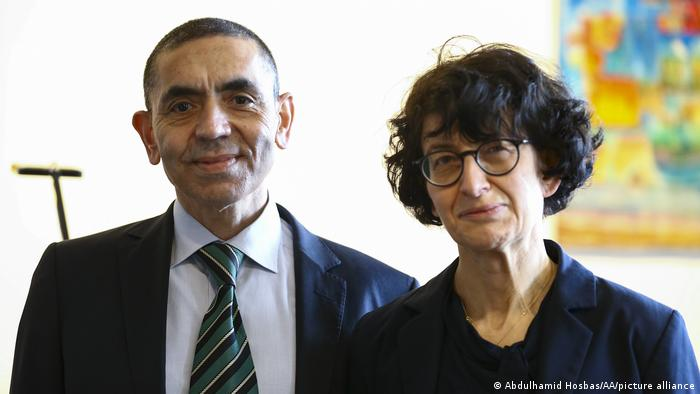 German scientists Ugur Sahin (L) and Ozlem Tureci (R) argue lockdowns will no longer be needed by the autumn