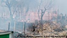 An aftermath of a fire is seen at a Balukhali refugee camp in Cox's Bazar, Bangladesh March 22, 2021 in this picture obtained from social media. Rohingya Right Team/Md Arakani/via REUTERS THIS IMAGE HAS BEEN SUPPLIED BY A THIRD PARTY. MANDATORY CREDIT