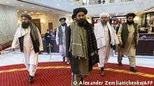 March 18, 2021*** Taliban co-founder Mullah Abdul Ghani Baradar (C) and other members of the Taliban delegation arrive to attend an international conference on Afghanistan over the peaceful solution to the conflict in Moscow on March 18, 2021. (Photo by Alexander Zemlianichenko / POOL / AFP)