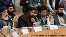 March 18, 2021*** Taliban co-founder Mullah Abdul Ghani Baradar (C) and other members of the Taliban delegation attend an international conference on Afghanistan over the peaceful solution to the conflict in Moscow on March 18, 2021. (Photo by Alexander Zemlianichenko / POOL / AFP)