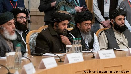 Taliban co-founder Mullah Abdul Ghani Baradar (center) and other Taliban delegates attend peace talks in Moscow on March 18, 2021