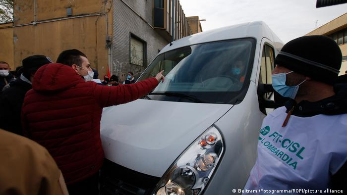Striking Amazon workers in Italy block a delivery van