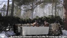 STYLELOCATIONRussian President Vladimir Putin takes a lunch break with Defense Minister Sergei Shoigu, left, during a weekend trip to the Russian Siberian taiga forest March 21, 2021 in Tuva, Russia. Tuva Russia - ZUMAp138 20210321_zaa_p138_007 Copyright: xAlexeixDruzhinin/KremlinxPoolx