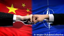 China vs NATO conflict, international relations crisis, fists on flag background
