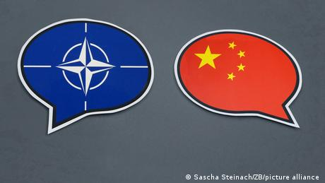 NATO and China flags in speech bubbles