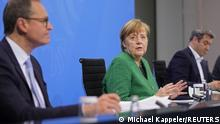 German Chancellor Angela Merkel attends a news conference after a meeting with state leaders to discuss options beyond the end of the pandemic lockdown, amid the outbreak of the coronavirus disease (COVID-19), in Berlin, Germany, March 23, 2021. Michael Kappeler/Pool via REUTERS