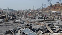 "*** Dieses Bild ist fertig zugeschnitten als Social Media Snack (für Facebook, Twitter, Instagram) im Tableau zu finden: Fach ""Images"" —> Rohingya - Brand im Flüchtlingslager Balukhali Cox's Bazar*** 23.03.21 *** People are seen amidst the debris at a Rohingya refugee camp in Ukhia on March 23, 2021 after a huge blaze forced around 50,000 people to flee. (Photo by - / AFP)"