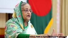 (200331) -- DHAKA, March 31, 2020 (Xinhua) -- Bangladeshi Prime Minister Sheikh Hasina speaks at a video conference from her office in Dhaka, Bangladesh on March 31, 2020. Bangladeshi Prime Minister Sheikh Hasina on Tuesday said the government will extend the ongoing shutdown to manage the spread of COVID-19. She announced the government's plan while holding a video conference with senior government officials at the country's 64 districts. (PID/Handout via Xinhua)