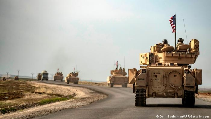 US troops ride Bradley tanks on patrol near Iraq's border with Syria