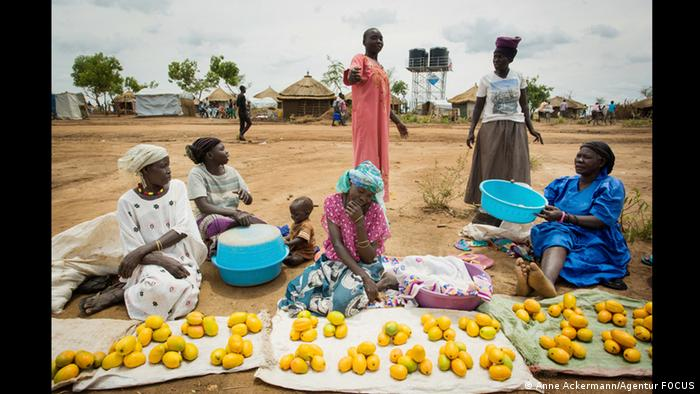 Women at a market in Uganda