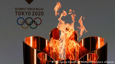 The celebration cauldron is lit in Tokyo
